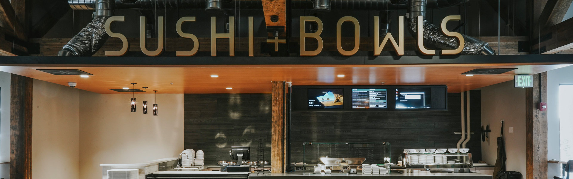 Sushi + Bowls sign over the kitchen